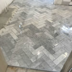 Grey herringbone tile